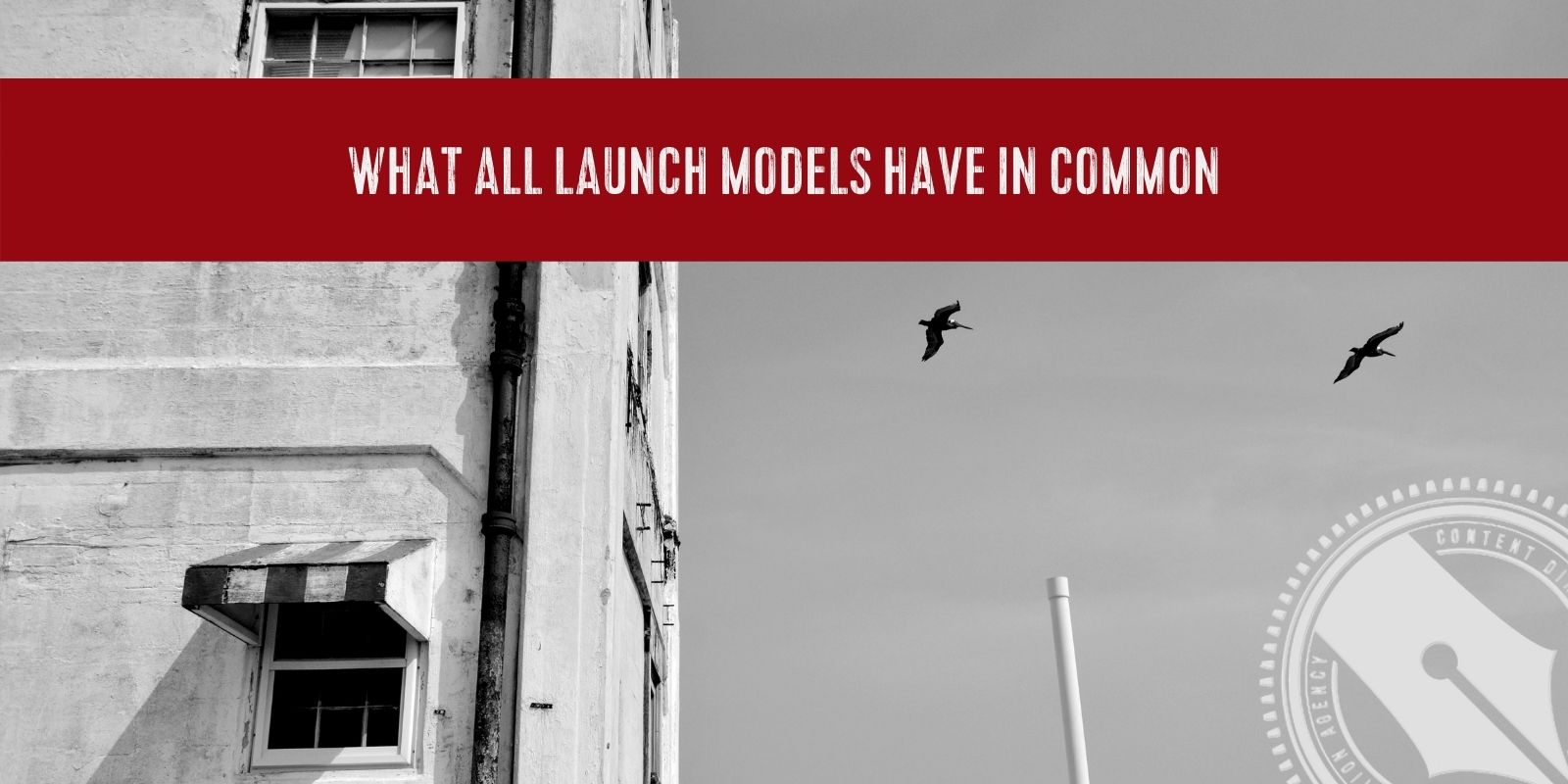 """[A red banner with the title of this week's blog, """"what all launch models have in common"""" spans across a black and white image of a building with a bird flying in the sky.]"""